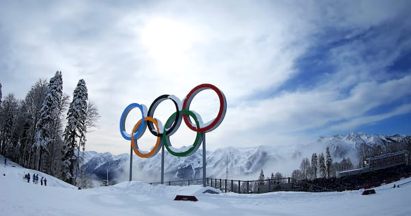 science & tech, The Olympic rings with snowy mountains in the background.