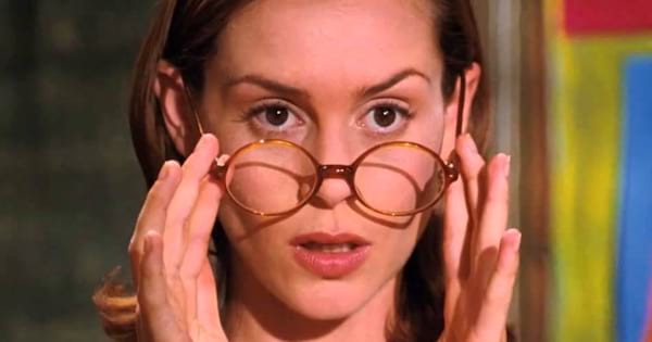 Miss Honey lowering her glasses in amazement at Matilda's powers in the movie Matilda