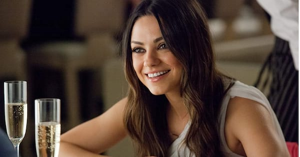 Mila Kunis at dinner with champagne