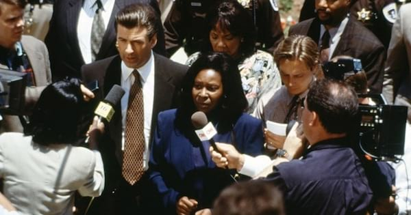 southern movies, alec baldwin and whoopi goldberg in ghosts of mississippi dressed up for court with reporters holding microphones to them