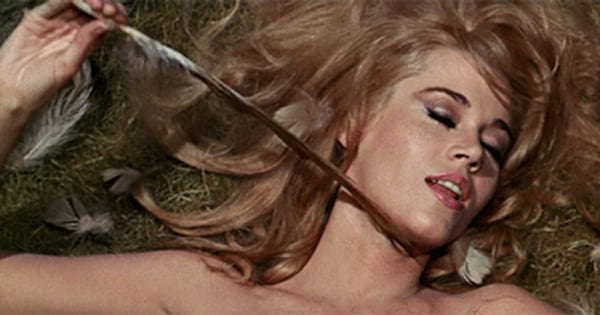 Jane Fonda as Barbarella playing with a feather