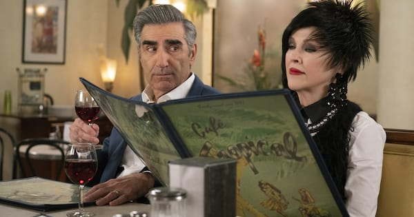 Eugene Levy and Catherine O'Hara eating dinner in 'Schitt's Creek'