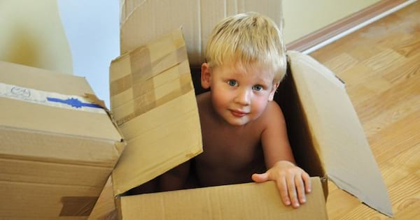 books, photo of a young white child sitting in an empty cardboard box, books about moving