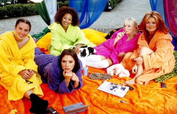 The Spice Girls in Spice World in colorful robes and blankets